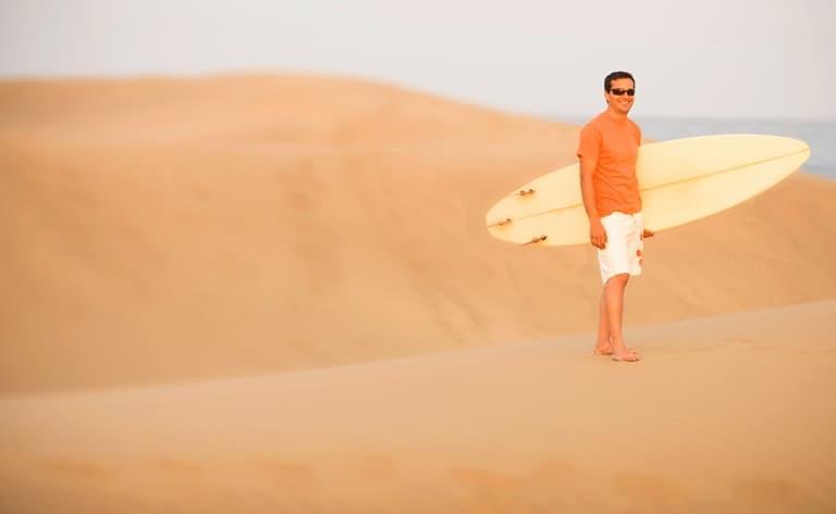 Séance de surf sur les dunes